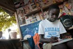 work & youth – boy working at a video and game rental in a slum for the internally displaced, freetown, sierra leone