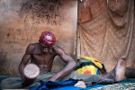work & youth – young man finishing wax print fabrics, labe, guinea conakry
