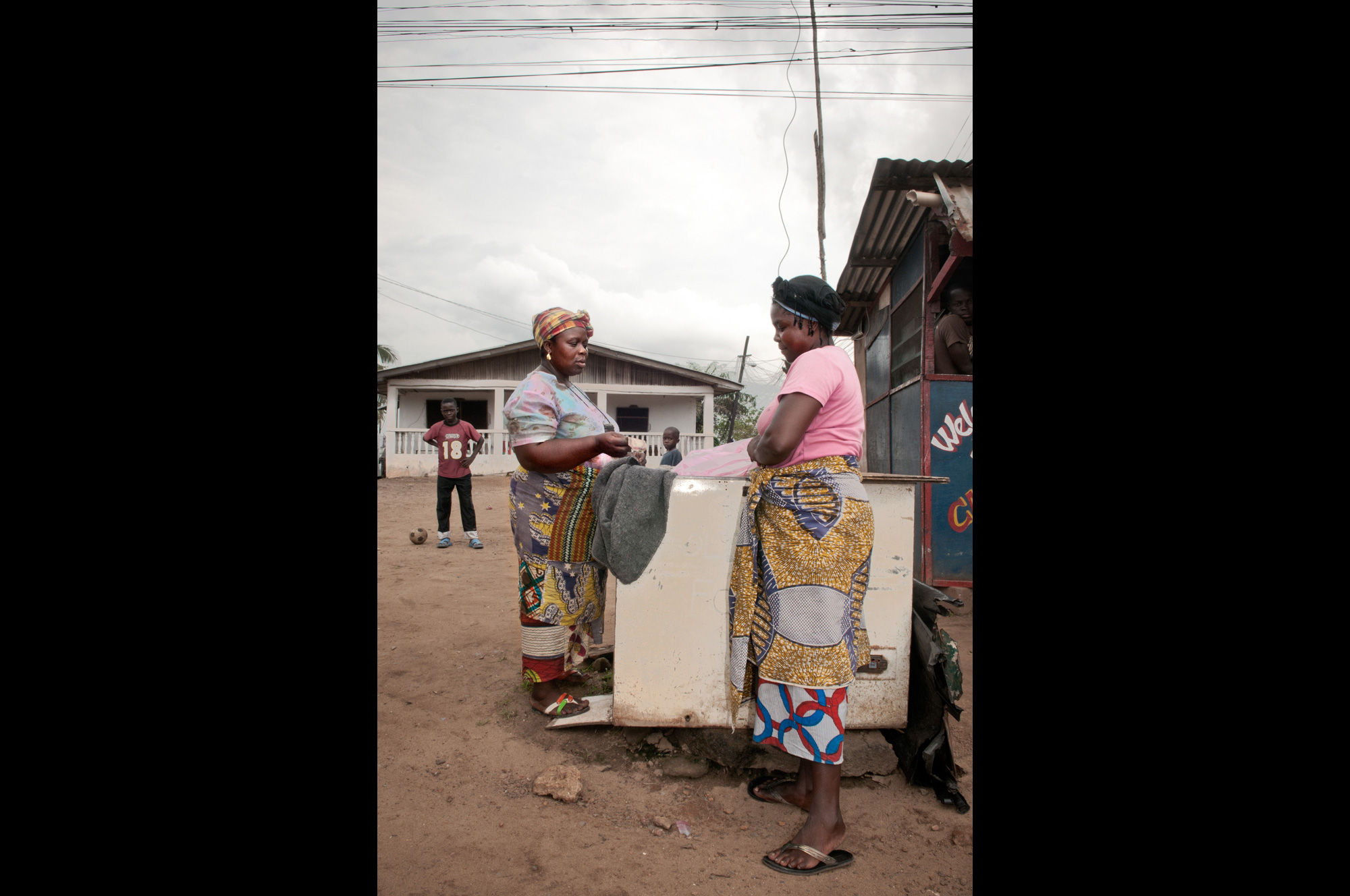 work & youth – woman selling ice along the road, monrovia, liberia